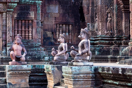 Ancient statues at the Banteay Srey Temple in Angkor Area, Cambodia. Banteay Srey is a 10th century Cambodian temple dedicated to the God Shiva.