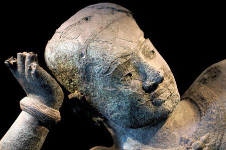 Ancient bronze statue of reclining Vishnu, West Mebon, Angkor on January 10, 2013 in Phnom Penh National Museum, Cambodia