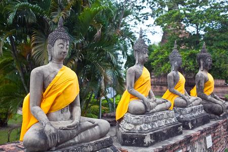 chaimongkol: Row of ancient Buddha Statues at Wat Yai Chaimongkol in Ayutthaya, Thailand