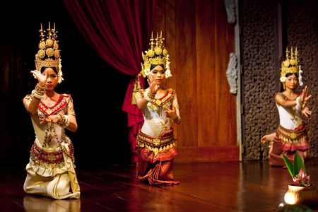 apsara: SIEM REAP, CAMBODIA - JANUARY 4, 2013: Beautiful girls performing Apsara Dance in Siem Reap, Cambodia. Apsara Dance is the ancient classical dance form of Cambodia.