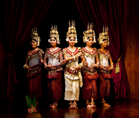 SIEM REAP, CAMBODIA - JANUARY 4, 2013: Beautiful girls performing Apsara Dance in Siem Reap, Cambodia. Apsara Dance is the ancient classical dance form of Cambodia.