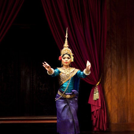 apsara: SIEM REAP, CAMBODIA - JANUARY 4, 2013: Beautiful girl performing Apsara Dance in Siem Reap, Cambodia. Apsara Dance is the ancient classical dance form of Cambodia.