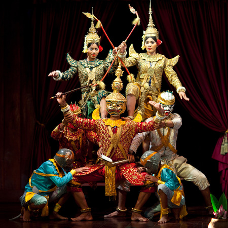 SIEM REAP, CAMBODIA - JANUARY 4, 2013: Khmer classical dancers performing in traditional costume on the evening show