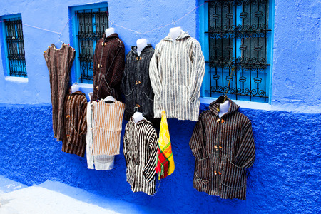 moroccan culture: On the narrow streets Chefchaouen seliing national clothes, Morocco