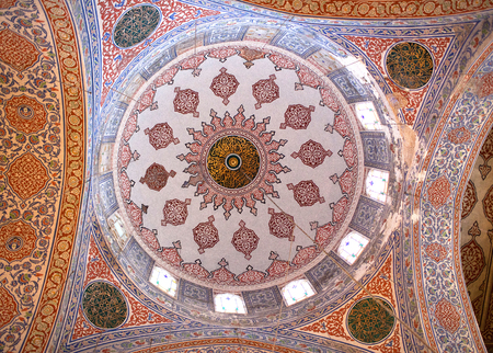 adorning: Ceiling detail in the Blue Mosque in Istanbul, Turkey. The Sultan Ahmed Mosque is a historic mosque in Istanbul. The mosque is popularly known as the Blue Mosque for the blue tiles adorning the walls of its interior