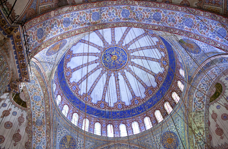 arhitecture: Ceiling detail in the Blue Mosque in Istanbul, Turkey. The Sultan Ahmed Mosque is a historic mosque in Istanbul. The mosque is popularly known as the Blue Mosque for the blue tiles adorning the walls of its interior