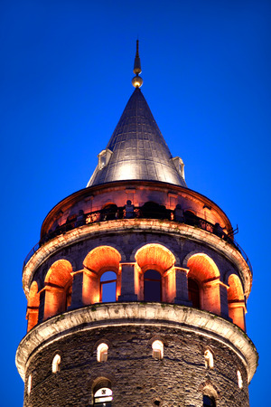 Famous Galata tower in Istanbul, Turkey. The Romanesque style tower was built as Christea Turris (Tower of Christ) in 1348 during an expansion of the Genoese colony in Constantinople. Galata Tower was the tallest building in Istanbul at 66.9 m when it was Editorial