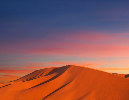 Sand dunes in Sahara desert at sunset