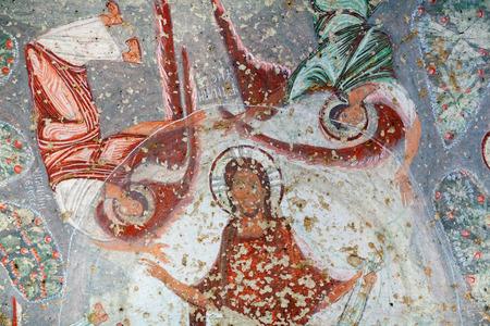 pintura rupestre: Fresco antiguo en la Iglesia del emperador Focas Nicaphorus en Capadocia, Turquía. Cavusin Church es una iglesia de 1.000 años de antigüedad que está tallada en la roca. Editorial