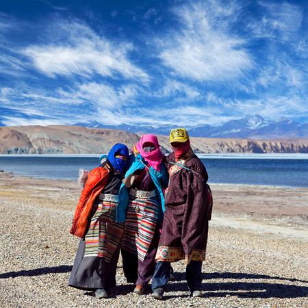 village man: NGARI, TIBET - MAY 7, 2013: Tibetan pilgrims in national clothes on the trail around holy Manasarovar lake in Tibet Autonomus Region of China Editorial