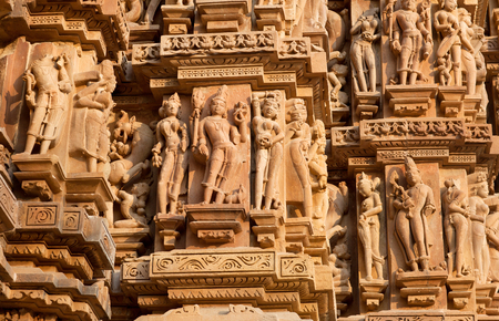 Ancient bas-relief at famous erotic temple in Khajuraho, India. Most Khajuraho temples were built between 950 and 1050 by the Chandela dynasty.