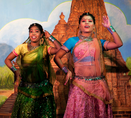 KHAJURAHO, INDIA - JANUARY 5, 2016: Beautiful Indian girls dancing traditional Indian dance in Khajuraho, India.