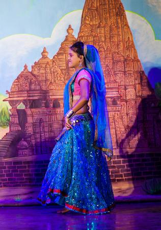 KHAJURAHO, INDIA - JANUARY 5, 2016: Beautiful Indian girls dancing traditional Indian dance in Khajuraho, Madhya Pradesh, India.