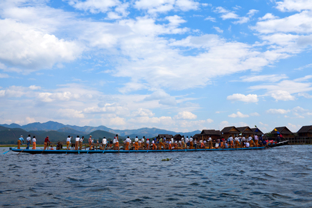Team of Burmese leg rowers crossing the lake during annual Buddhist Phaung Daw U festival on January 17, 2011 on Inle Lake, Shan State, Myanmar.