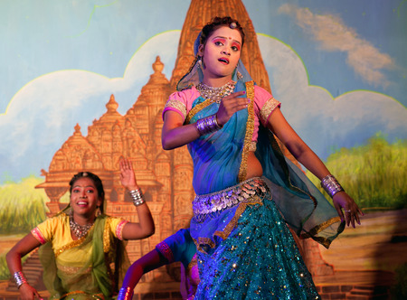 KHAJURAHO, INDIA - JANUARY 5, 2016: Indian girls performing traditional Indian dance