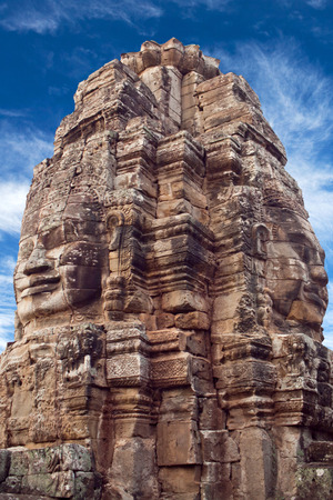 Giant stone face of Prasat Bayon temple (late 12th - early 13th century) in Angkor Thom, Cambodia