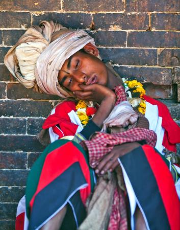 Nepalese Pujari sleeping during harvest fesival on April 01, 2010 in Bhaktapur, Kathmandu valley, Nepal