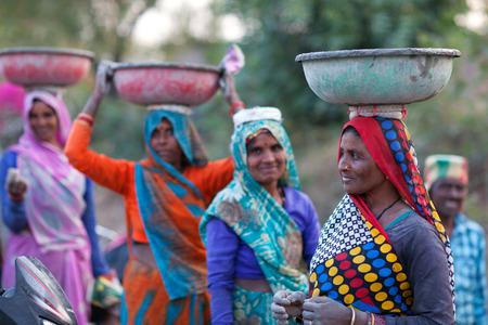 KHAJURAHO, INDIA - JANUARY 5, 2016: Indian women working hard in road-building in Khajuraho, Madhya Pradesh State, India