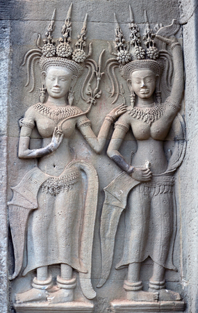 Ancient reliefs at Angkor Wat temple, Cambodia. Angkor Wat was built between 1113 and 1150 by King Suryavarman II. Фото со стока