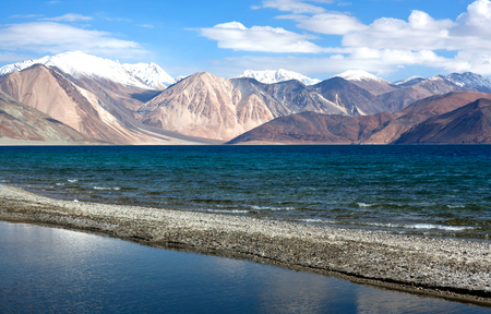 Pangong Lake in Ladakh, North India. Pangong Tso is an endorheic lake in the Himalayas situated at a height of about 4,350 m. It is 134 km long and extends from India to Tibet. Stock Photo