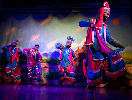 KHAJURAHO, INDIA - JANUARY 5, 2016: Indian dancers performing traditional Indian dance
