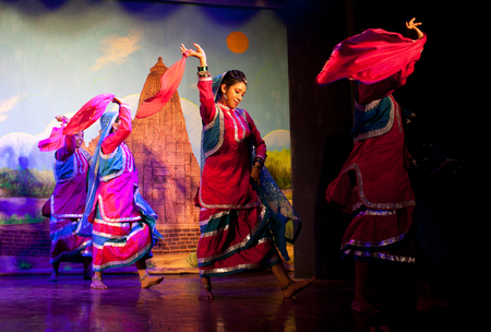 KHAJURAHO, INDIA - JANUARY 5, 2016: Young Indian dancers performing traditional Indian dance Editorial