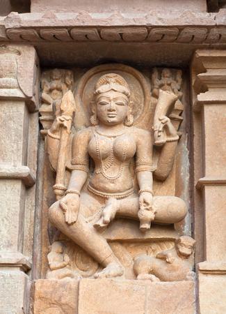 kamasutra: Goddess Durga - ancient stone relief at famous temple in Khajuraho, India