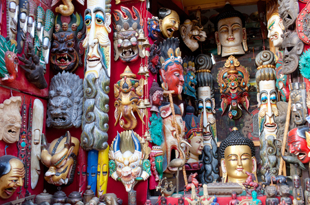 BHAKTAPUR, NEPAL - JANUARY 23, 2017: Colorful wooden masks and handicrafts on sale at shop at Durbar Square in Bhaktapur, Kathmandu valley.