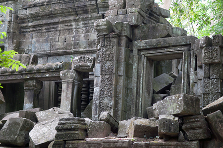 Ruins of ancient Beng Mealea Temple over jungle in Cambodia. Beng Mealea (early 12th century) is a temple located 40 km east of the main group of temples at Angkor, its name means lotus pond Stock Photo