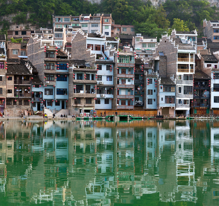 riverbank: Panorama of Zhenyuan Ancient Town on Wuyang river in Guizhou Province, China. It is under the administration of the Qiandongnan Miao and Dong Autonomous Prefecture