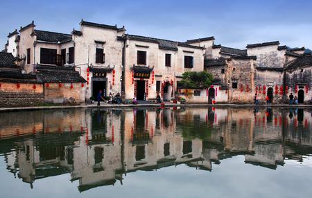 riverside county: HONGCUN, CHINA - APRIL 20, 2014: Tourist walking around Moon Lake in Hongcun Village. Hongcun is ancient village in Anhui Province, near the southwest slope of Mount Huangshan.
