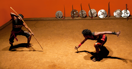 disarm: KERALA, INDIA - JANUARY 18, 2016: Indian fighters performing Kalaripayattu marital art demonstration