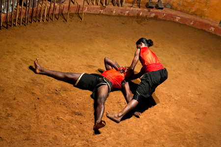 disarm: KERALA, INDIA - JANUARY 19, 2016: Indian fighters performing Kalaripayattu marital arts demonstration in Kerala, India. Kalaripayattu is an ancient form of martial art of Kerala dating back to almost 2000 years. Editorial