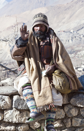 MUKTINATH, NEPAL - DECEMBER 24, 2010: Sadhu (Holy man) seeking alms in Vishnu temple Editorial