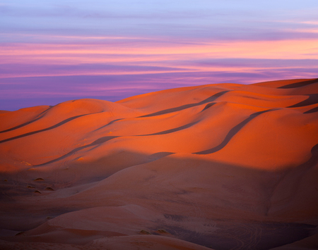 Sand dunes in Sahara desert at sunset in Morocco, Africa Stock Photo