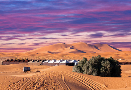 Camp site with tents over sand dunes in Merzouga, Sahara desert, Morocco, Africa