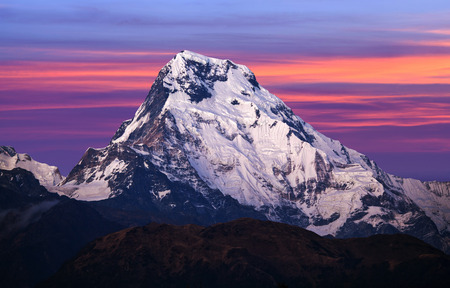 Panorama of mount Annapurna South at sunset - view from Poon Hill on Annapurna Circuit Trek in the Nepal Himalaya