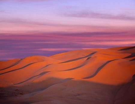 Sand dunes at sunset in Sahara desert in Morocco, Africa Stock Photo