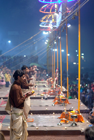 VARANASI, INDIA - JANUARY 3, 2016: Indian Brahmins conducts religious Ganga Maha Aarti ceremony (fire puja) at Dashashwamedh Ghat in Varanasi, Uttar Pradesh, India