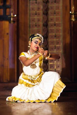 COCHIN, INDIA - JANUARY 21, 2016: Beautiful Indian girl dancing Mohinyattam (Dance of enchantress) in Fort Cochin, South India. Mohiniyattam is traditional South Indian dance from Kerala