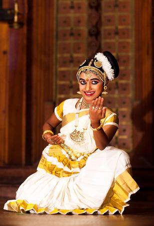 COCHIN, INDIA - JANUARY 21, 2016: Beautiful Indian girl dancing Mohinyattam dance in Fort Cochin, Kerala