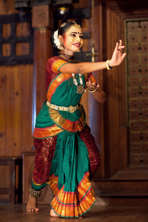 COCHIN, INDIA - JANUARY 21, 2016: Beautiful Indian girl dancing classical Indian dance Bharat Natyam in Fort Cochin, Kerala Editorial