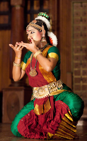 COCHIN, INDIA - JANUARY 21, 2016: Beautiful Indian girl dancing classical traditional Indian dance Bharat Natyam