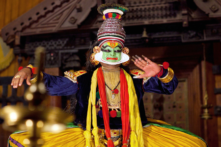 FORT COCHIN, INDIA - JANUARY 22, 2016: Actor performing traditional Indian dance-drama Kathakali in Fort Cochin, Kerala, South India. Kathakali - the classical dance-drama of Kerala based on Indian mythology, and noted for its elaborate costumes and gestu