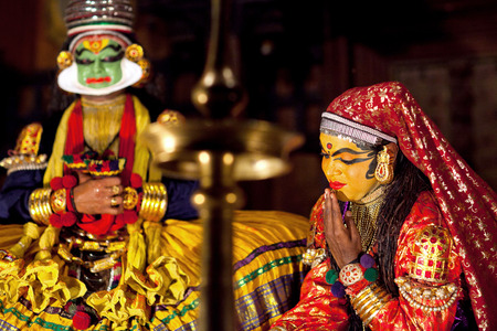 FORT COCHIN, INDIA - JANUARY 22, 2016: Actors performing traditional Indian dance-drama Kathakali in Kerala Kathakali Center in Fort Cochin, Kerala, South India. Kathakali - the classical dance-drama of Kerala based on Indian mythology, and noted for its