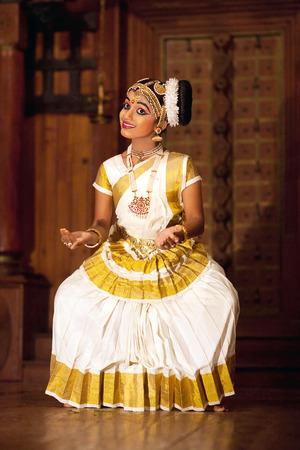 COCHIN, INDIA - JANUARY 21, 2016: Beautiful Indian girl dancing Mohinyattam Dance in Fort Cochin, South India. Mohiniyattam is traditional South Indian dance from Kerala