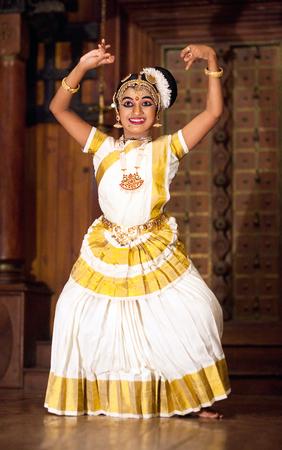 FORT COCHIN, INDIA - JANUARY 21, 2016: Beautiful Indian girl dancing Mohinyattam Dance in Fort Cochin, South India. Mohiniyattam is traditional South Indian dance from Kerala