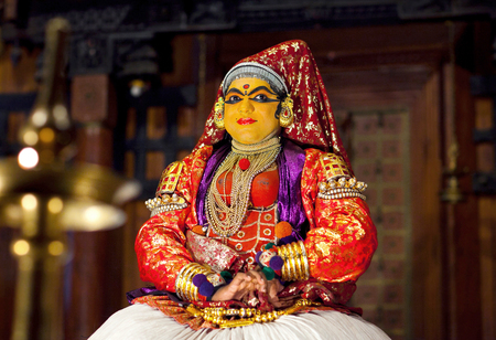 COCHIN, INDIA - JANUARY 22, 2016: Actor performing traditional Indian dance-drama Kathakali in Fort Cochin, Kerala, South India. Kathakali - the classical dance-drama of Kerala based on Indian mythology, and noted for its elaborate costumes and gestures. Editorial