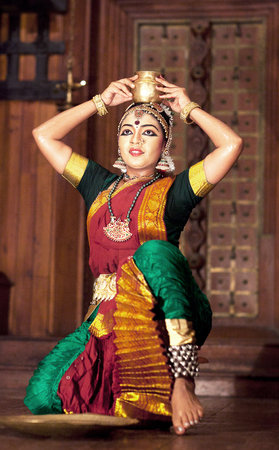 COCHIN, INDIA - JANUARY 21, 2016: Beautiful Indian girl dancing traditional Indian dance Kuchipudi in Fort Cochin, South India. Editorial