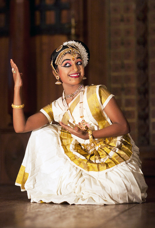 COCHIN, INDIA - JANUARY 21, 2016: Young Indian girl dancing Mohinyattam Dance. Mohiniyattam is traditional South Indian dance from Kerala Editorial